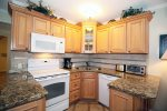 Cozy kitchenette with all necessary appliances, cookwares, dishwasher, and additional seating at the breakfast bar